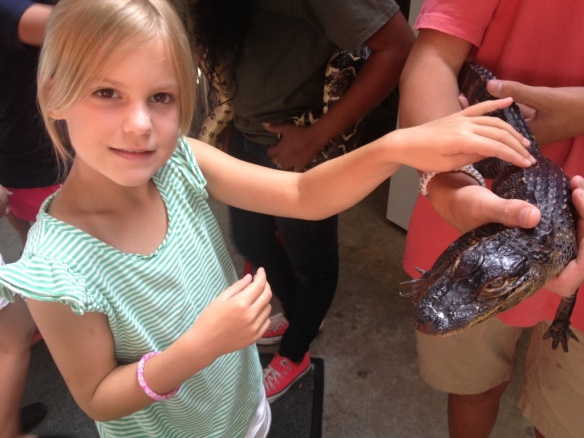 Ella with 8 yr. old miniature alligator.