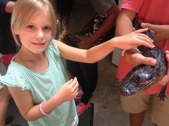 Ella with 8 yr. old miniature alligator.